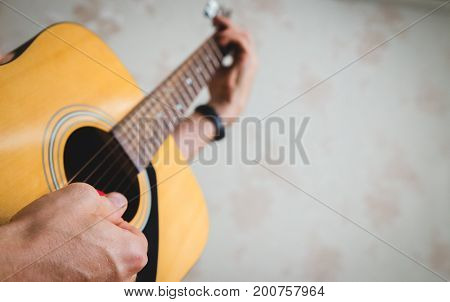playing on the acoustic, six-string classical guitar