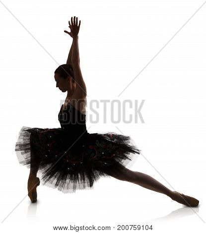 A ballerina silhouette in ballet position against white background, isolated. Professional dancer in tutu skirt. Choreography classes concept