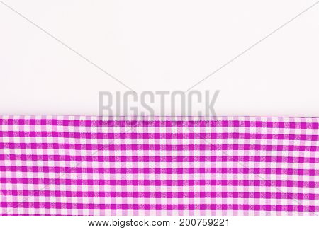 Pink, purple fabric, a kitchen towel with a checkered pattern, on a white background isolated.