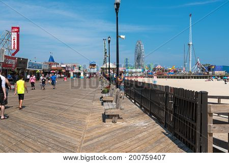 Seaside Heights NJ USA -- August 21 2017 -- People are walking along the Seaside Heights boardwalk on a hot summer day. Editorial Use Only.