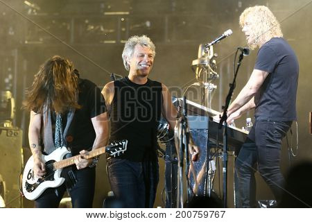 ENDICOTT, NY-Aug 18: (L-R) Phil X, Jon Bon Jovi and David Bryan perform in concert at En-Joie Golf Course on August 18, 2017 in Endicott, New York.