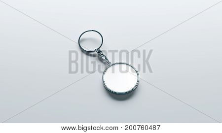 Blank metal round white key chain mock up isometric view 3d rendering. Clear silver circular keychain design mockup isolated. Empty plain keyring souvenir holder template. Steel circle trinket label
