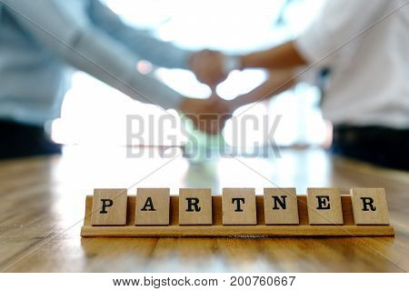 Key Word Partner On Wood Table Part Of Business Working.