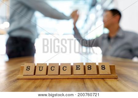 Key Word Success On Wood Table Part Of Business Working.  Concept Work Success  Business Teamwork.
