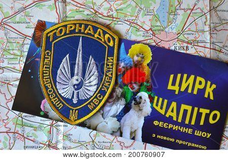 ILLUSTRATIVE EDITORIALChevron of Ukrainian battalion Tornado .The battalion disbanded for pederastic rapes kids,executions&torture. Poster - FEIR SHOW.Shapito circus (UKR).Kiev,Ukraine.August 20, 2017