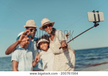 Family Taking Selfie At Seaside
