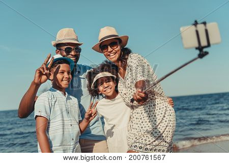 Family Taking Selfie On Beach