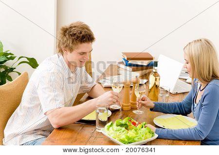 Happy Couple Enjoy Wine Eat Salad In Kitchen