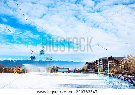 Bansko, Bulgaria - February 19, 2015: Winter ski resort Bansko, ski slope, people skiing and mountains view