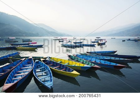Boats at Phewa Lake in the evening Pokhara Nepal