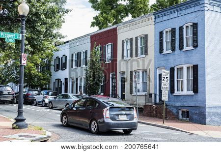 Washington DC, United States of America - August 6, 2017: Quiet Residential Street in Georgetown with Colorful Row Houses and Cars