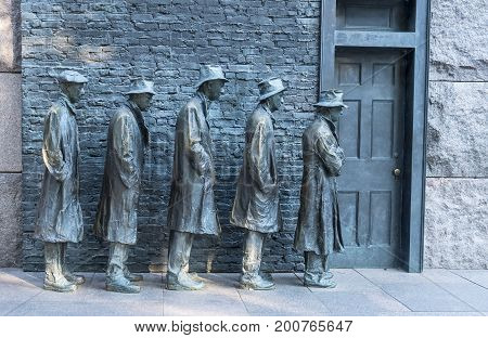Washington DC, United States of America - August 5, 2017: Bronze Statues Men Waiting in Line to Get Food During the Great Depression
