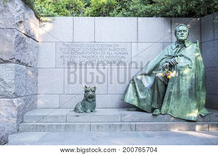 Washington DC, United States of America - August 5, 2017: Franklin Roosevelt's Memorial Monument with Bronze Statues of Franklin Roosevelt and His Beloved Dog