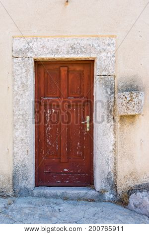 Old Ancient Ruined Worn Eroded Red Door On Side Of Cathedral Beautiful Medieval Vintage Architectura