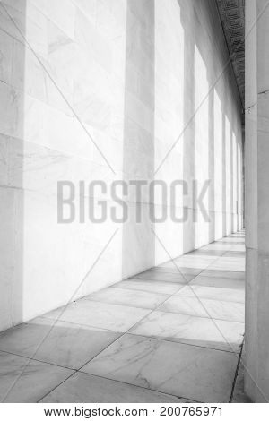 Black and White Photographs of a Series of Columns and Their Shadows