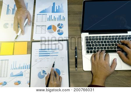Business Team Man And Woman Work With Laptop On Wood Table