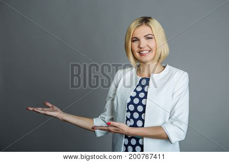 Young girl points with hands
