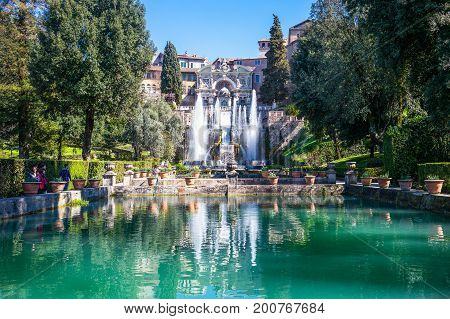Tivoli Italy - March 12 2014: Villa D'Este the Neptune fishpond with the Organ fountain in the background