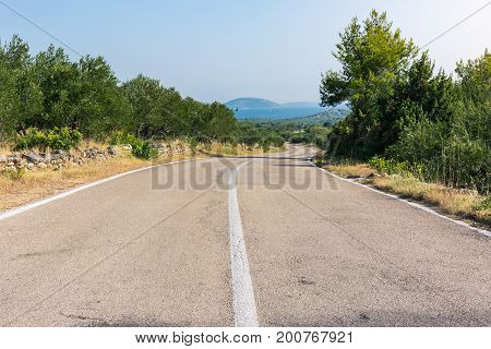 Scorching Hot Croatian Landscape Summer Day Road Perspective Valley And Mountains