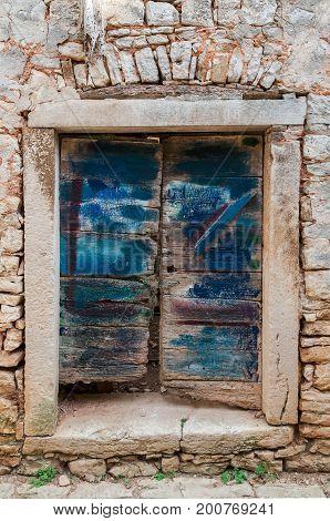 Old door wit original blue painting Croatia, Bale, HR