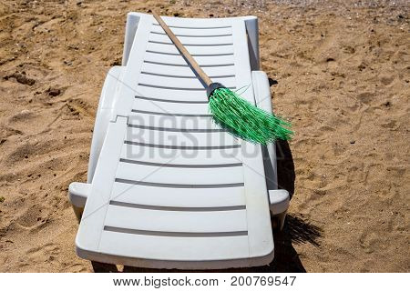 Plastic white sun lounger on the sand beach