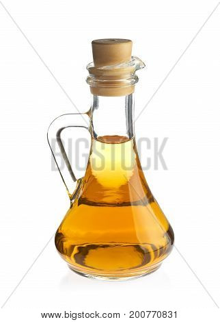 Decanter with organic apple vinegar, isolated on white background.