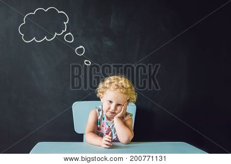 Closeup Portrait Of Cute Little Girl Thinking Deeply About Something Copy Space