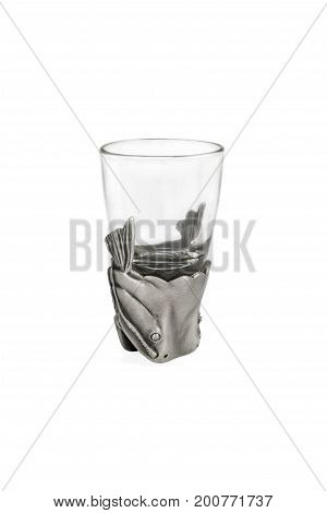 Souvenir glass with a fish head on the bottom, isolated on a white background