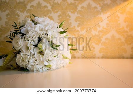 White wedding bride bouquet on the table.