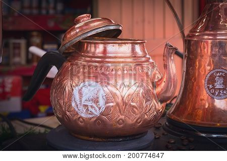 Greece, Drama - December 14, 2016: Copper brewing teapot in Greek traditional market