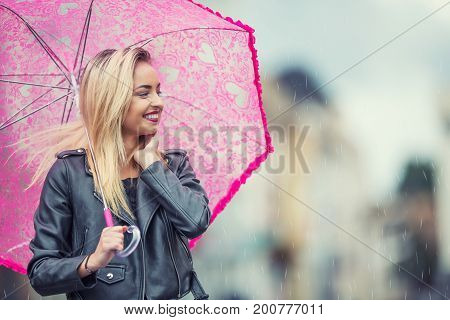 Attractive Young Woman With Pink  Umbrella In The Rain And Strong Wind. Girl With Umbrella In Autumn