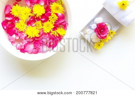 Thai Spa relax Treatments and massage with pink rose and yellow flower on wooden white. Healthy Concept. select and soft focus