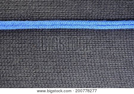 Texture of gray and blue woolen knitted fabric background