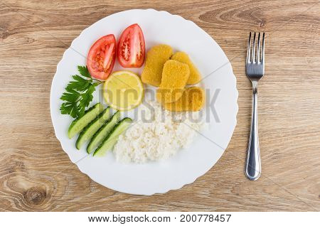 Chicken Nuggets With Rice, Vegetables, Parsley, Lemon In Plate
