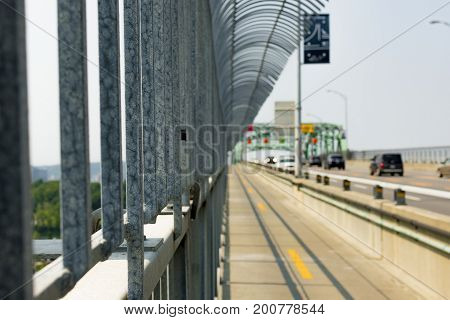 Close up of an anti-suicide bridge fence with a blured background
