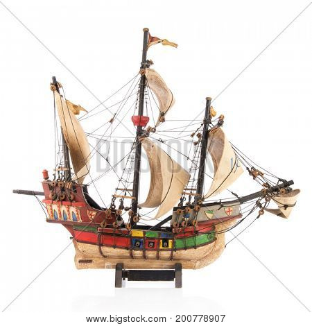 old wooden handmade boat Santa Maria from Columbus isolated over white background