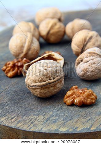 whole and chopped walnuts on the natural background