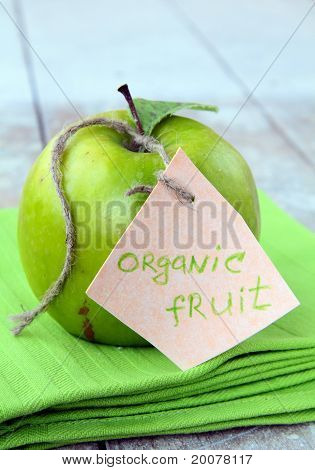fresh organic green apple on the natural background
