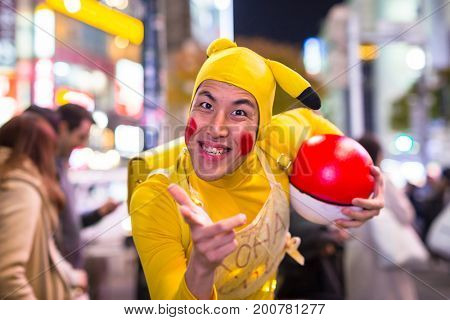 TOKYO, JAPAN - NOVEMBER 12, 2016: Man dressed up like Pikachu at Shibuya crosswalk in Tokyo, Japan. Pikachu is a central character in the Pokémon anime series, famous in Japan.