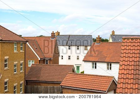 Suburbia. Houses on a modern suburban housing estate. Town living in various residential buildings.