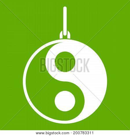 Yin Yang symbol icon white isolated on green background. Vector illustration