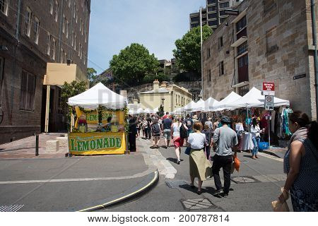 SYDNEY,NSW,AUSTRALIA-NOVEMBER 20,2016: Lemonade stand, vendors and tourists at The Rocks Markets in Sydney, Australia.