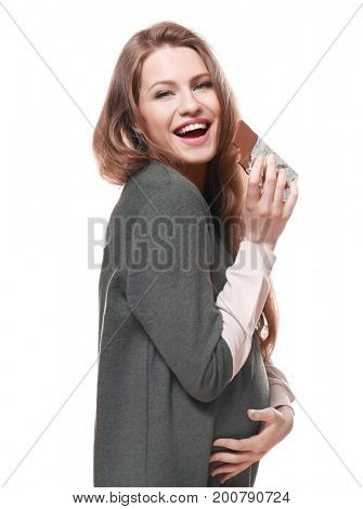 Emotional pregnant woman eating chocolate on white background. Pregnancy hormones concept