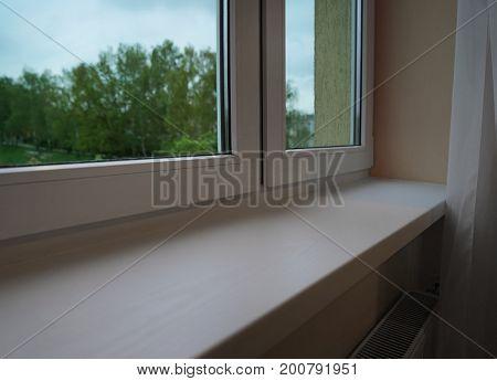 Modern plastic window sill indoors