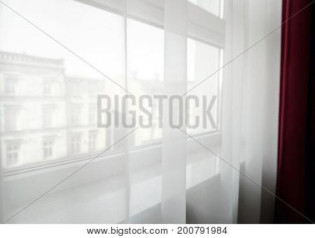 Transparent curtains on window