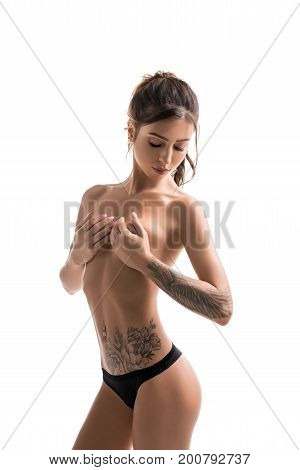 Slim tattooed brunette topless isolated shot on white background