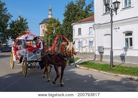 SUZDAL/ RUSSIA - AUGUST 19, 2017. A vintage horse-drawn carriage on the street of Suzdal, Vladimir region, Russia.