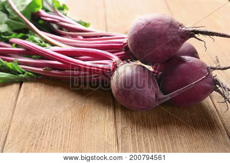 Bunch of young beets on wooden table