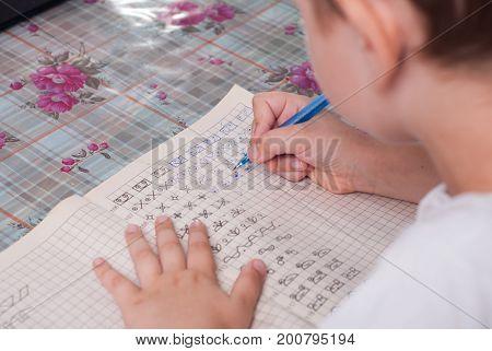 Boy Doing His Homework.