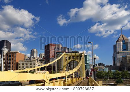 View of Pittsburgh PA skyline with blue sky and white clouds